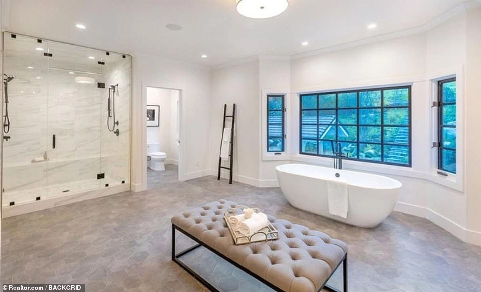 Scrub-a-dub-dub: The master bath has a separate lavatory, a standalone tub, a marble-lined steam shower large enough for two