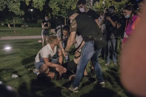 A protester in Belgrade receives first aid