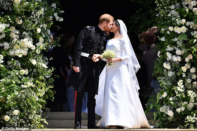 In hiding: 'I was trying to conceal the fact that I was five months pregnant. I was absolutely positive that it was going to be revealed,' Troian added. Meghan Markle and Prince Harry are pictured on their wedding day in May, 2018