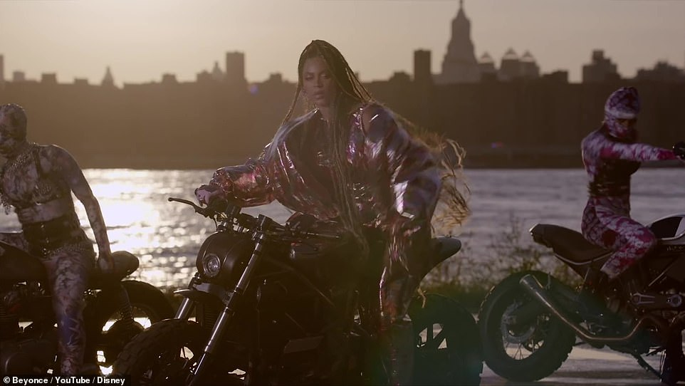 End: The video ends with a shot of Beyonce decked out in a silver ensemble sitting on a motorcycle with a city skyline in the background
