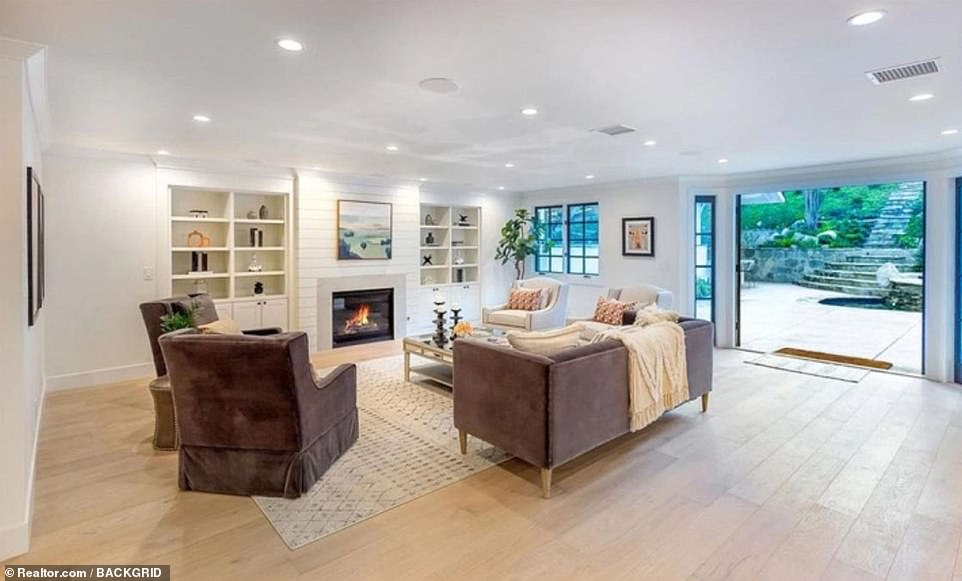 Indoor/outdoor living: The family room has a fireplace and opens out onto a terrace and patio