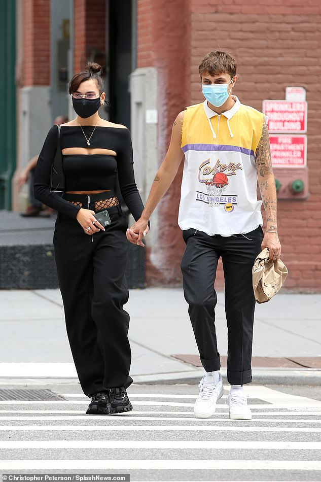 Looking good:The musician added a sweep of chic make-up to her face while her raven tresses were styled into a top knot