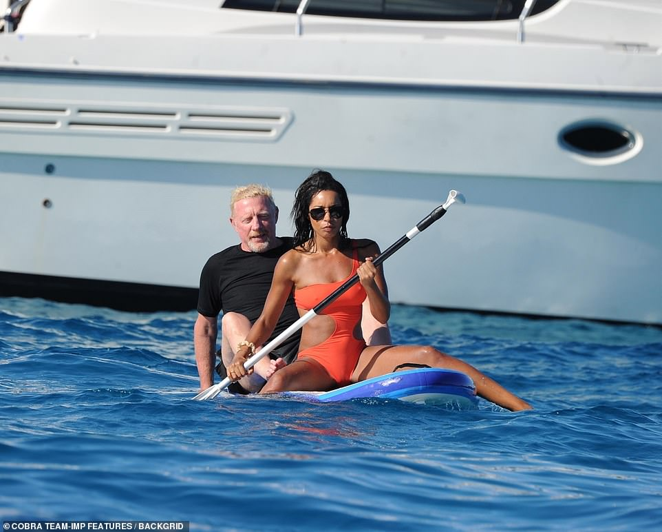 Out at sea! Lillian looked sensational during the trip in in a cut-away tangerine swimsuit as she enjoying the sunshine, before hopping in the water for a paddle boarding session with her new love