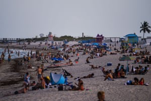 People relax on the beach in Miami Beach, Florida amid the coronavirus pandemic 28 July, 2020. The US corornavirus tally reached 5,000,603 cases on Sunday morning and 162,430 deaths - both totals by far the highest of any country in the world.