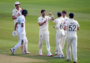 England's James Anderson celebrates taking the wicket of Pakistan's Shan Masood (left).