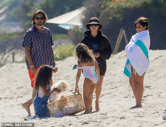 Another outing: Indeed Scott has been spending much quality time with his ex Kourtney and their three children Mason, 10, Penelope, eight, and Reign, five recently. Seen here last month