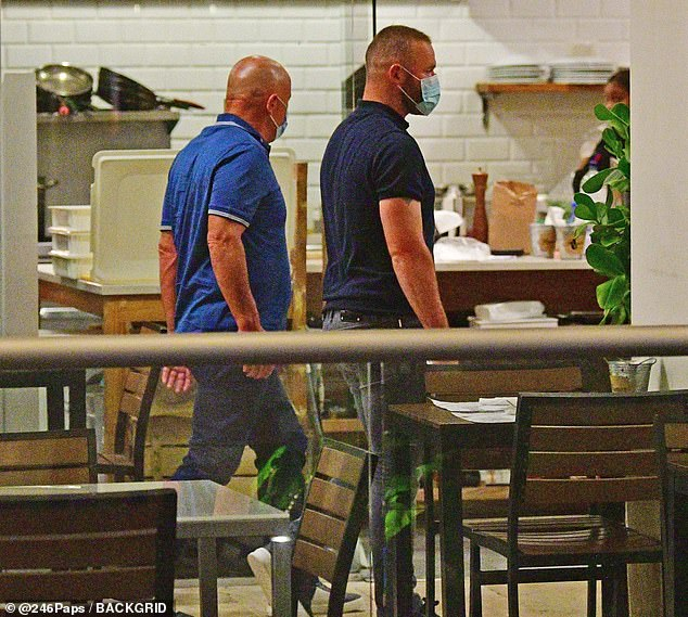 Going out: Coleen's husband Wayne was seen heading into the rooftop restaurant with father-in-law Tony