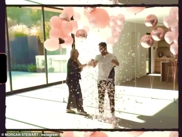 Baby shower: The couple look overjoyed as they're covered in pink confetti