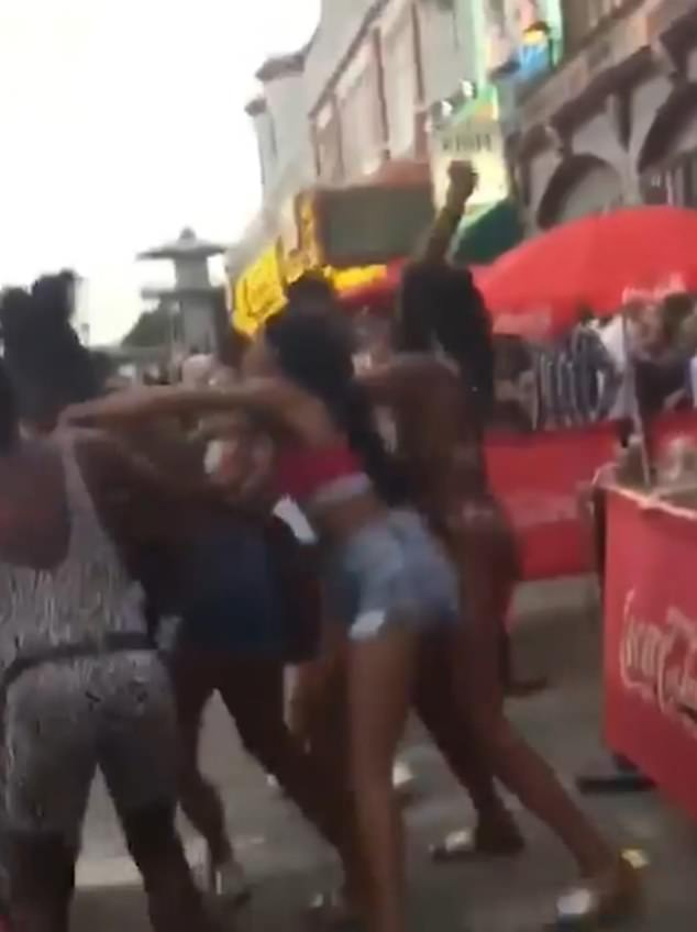 Violent! The video was shot by a bystander on their phone and sees five black women scuffling with a white woman, after she reportedly called one of them a 'f***ing black c***,' and yelling, 'f*** Black Lives Matter!'
