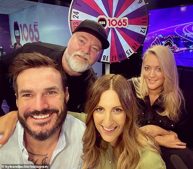 Cynical: Some Bachelor fans are convinced this seemingly innocent photo is 'proof' Locky Gilbert (left) and Irena Srbinovska (second from right) won't last. The couple are pictured on Friday with radio hosts Kyle Sandilands (second from left) and Jackie 'O' Henderson (right)