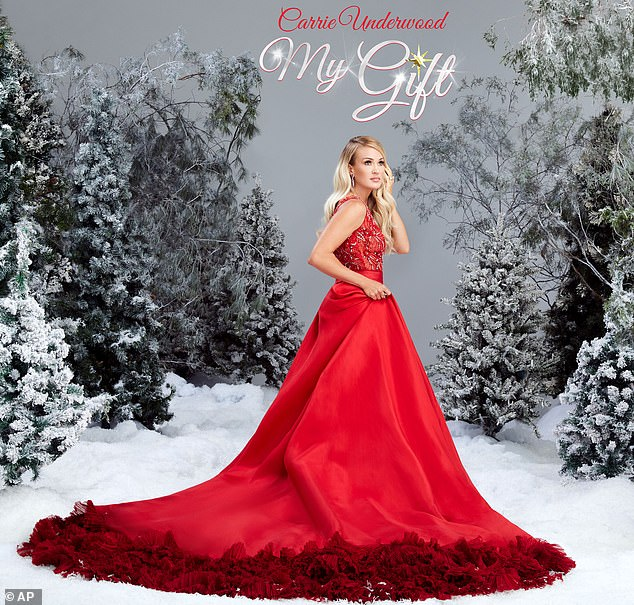 My Gift: Carrie Underwood, 37, released her debut Christmas album on Friday, sharing that her five-year-old son, Isaiah, who she shares with husband Mike Fisher, appears on her track Little Drummer Boy. Appearing on Today ahead of the release Carrie joked she was a 'stage mom'
