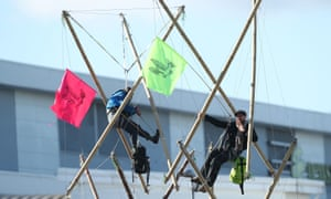 Extinction Rebellion protesters suspended outside the Newsprinters printing works at Broxbourne.