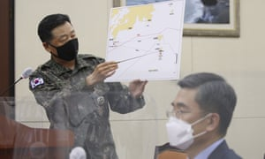 A South Korean military official gives a briefing on North Korea's shooting of a South Korean at the National Assembly in Seoul on Thursday.
