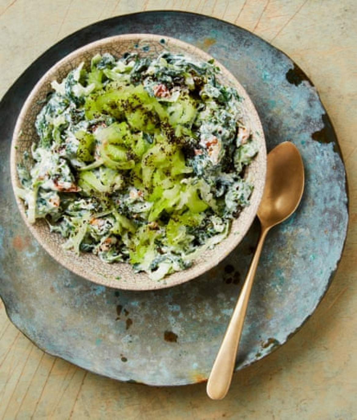 Yotam Ottolenghi's spinach borani with celery and walnuts.