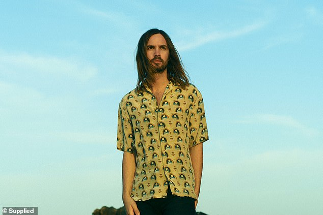Postponed: Tame Impala have announced they've had to postpone their Australian and New Zealand tour for the third time because of the ongoing coronavirus pandemic. Pictured, lead musician Kevin Parker