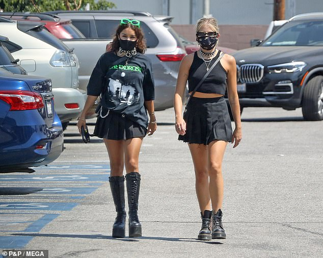 Here come the gothic girls:Her best pal GG Magree accompanied Vanessa on the trip and sported a matching miniskirt