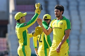 Starc celebrates with Carey after taking Curran.