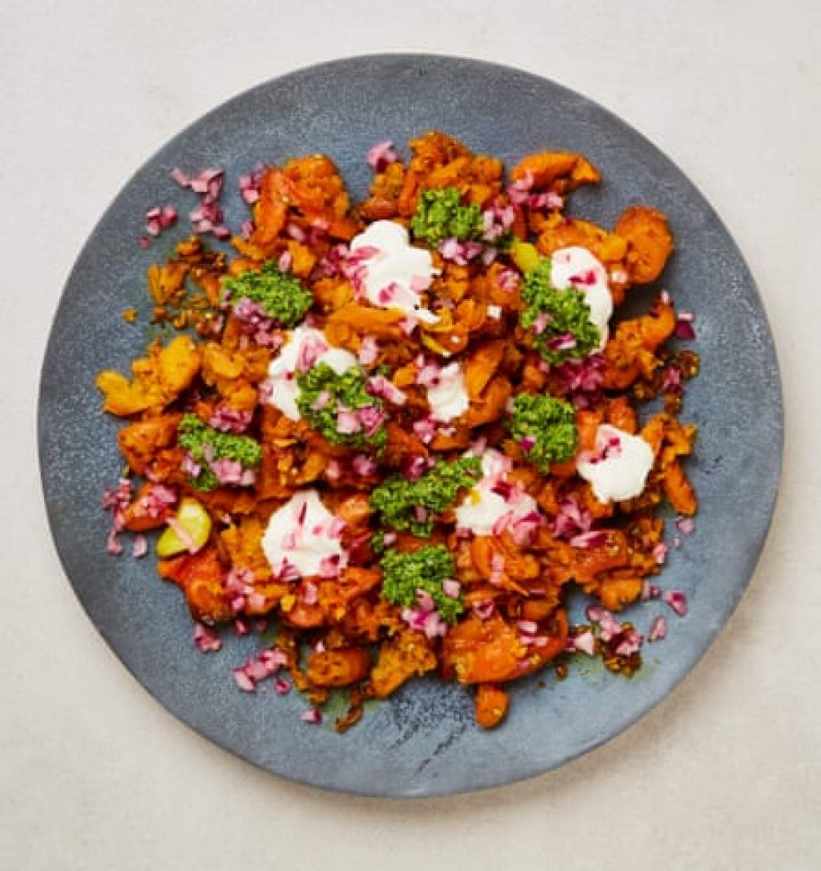 Yotam Ottolenghi's smashed carrots with coriander-pistachio pesto and pickled onions.
