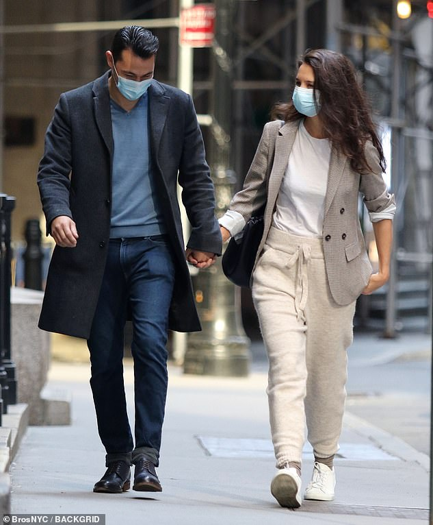 Masking it up: Following in Katie's footsteps, Emilio made sure to wear a face mask for their romantic outing