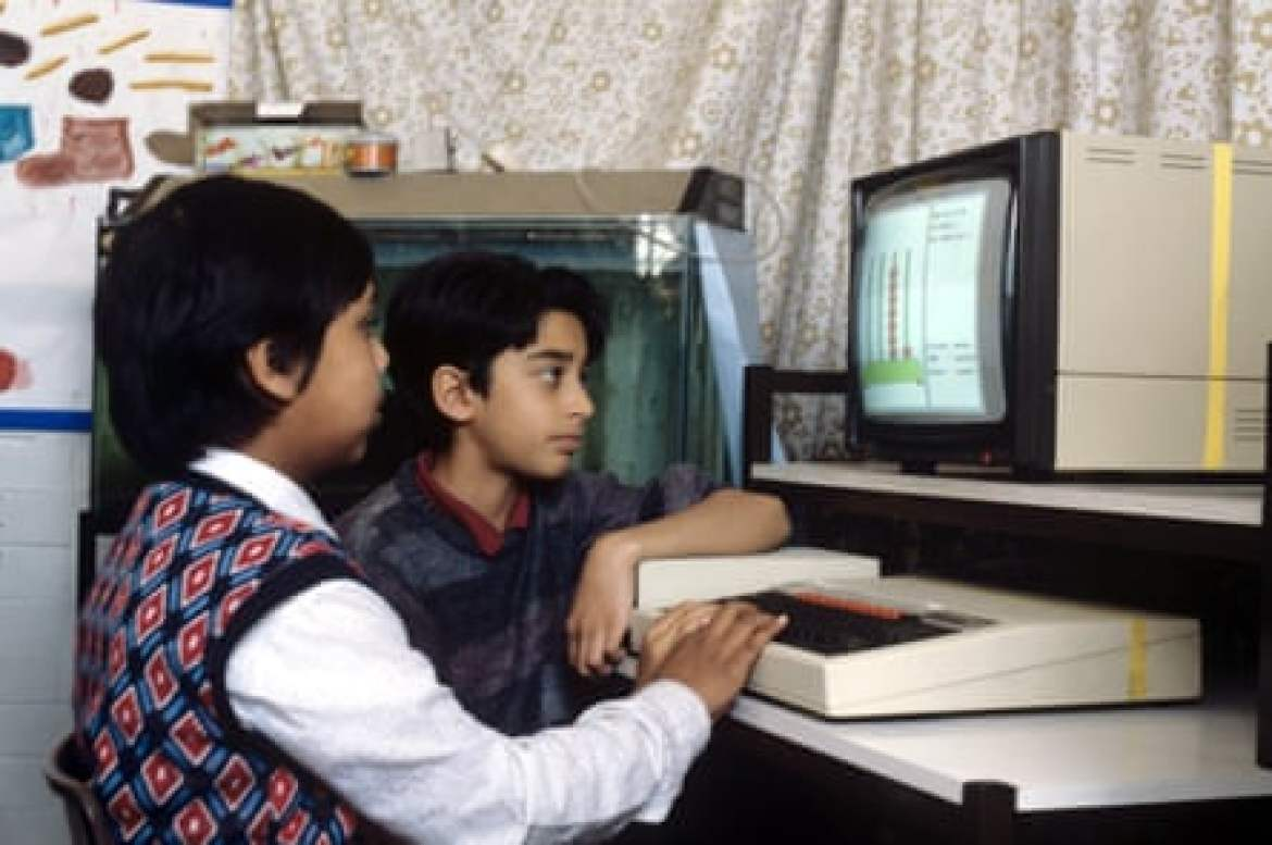 British primary school children learning maths on a BBC Micro.