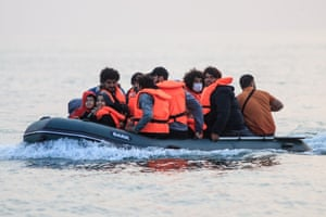 Waleed, right, crosses the Channel in a dinghy