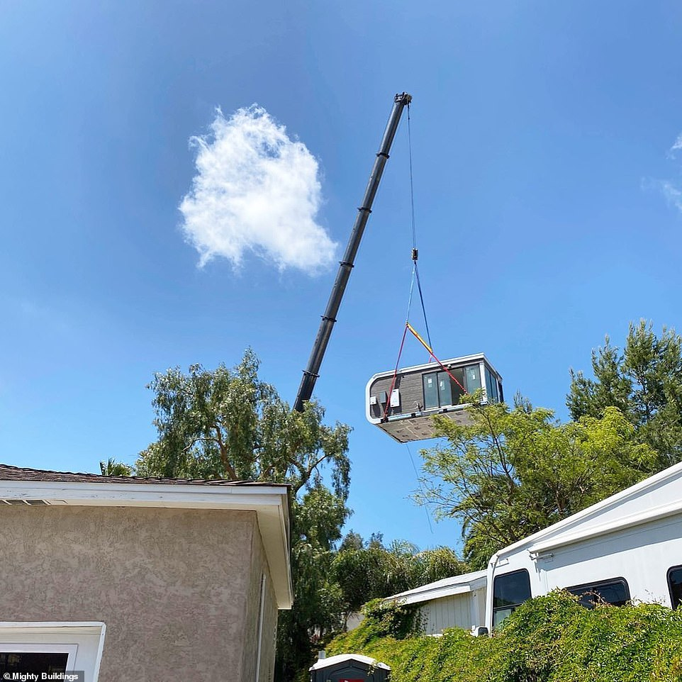 The unit is lifted into the customer's back garden using a crane, after being developed at Mighty Building facilities and transported on a truck
