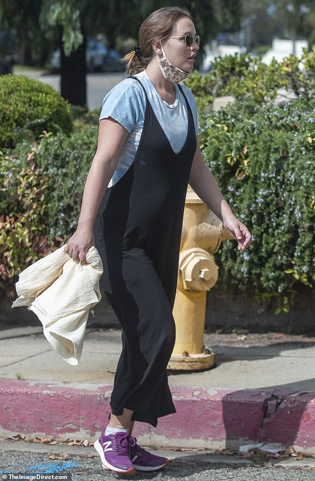 Post baby:And the 34-year-old Meester, who is best known for her work on Gossip Girl, was also seen earlier last week with no bump drawing speculation she had welcomed the child. She had on overalls and a blue shirt with her face mask pulled down as her spouse showed of new facial hair.