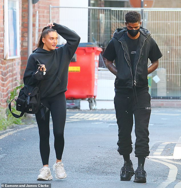 Casual:The Manchester United forward opted for a black gilet layered over a simple t-shirt with white writing as he walked with his hands in his pockets down the street