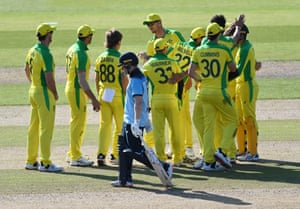 Zampa, congratulated after dismissing Morgan for 43.