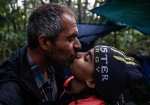 Falah kisses his daughter Arwa after getting her ready to be smuggled into Britain