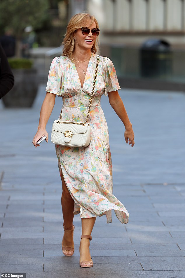 Designer:She shielded her eyes from the late September sun with cat-eye tortoise shell sunglasses and accessorised her look with a white £1,890 Gucci Marmont handbag