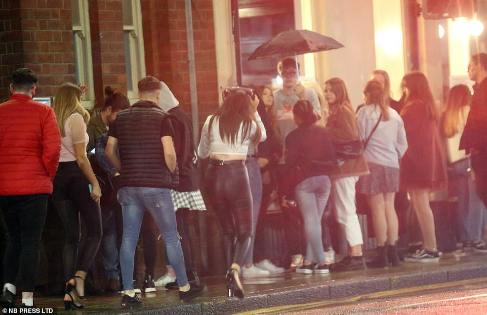 Wednesday night out in Leeds: Revellers queue up to party on the last night before the new 10pm curfew announced by Prime Minister Boris Johnson