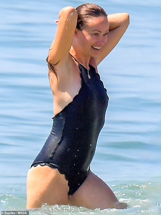 Air dry: Wilde pulled her hair back, after taking a dip in the water