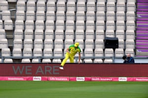 Australia's Pat Cummins fetches the ball from the stands after a six.