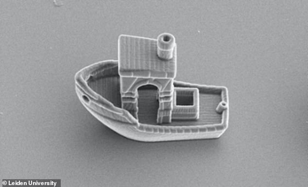 From prow to stern, this little boat measures 30 micrometers or about 0.001 inches and required an electron microscope to capture an image of the completed object