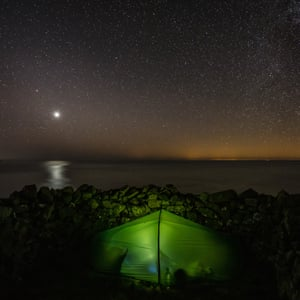 Venus above camp at Penbwchdy, Pembrokeshire. The Glow across the sea is Ireland.