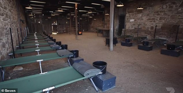 Basic: Foxy then showed them where they'd all be sleeping, as they were led into a barn-style room with a dirt floor and rows of stretcher beds