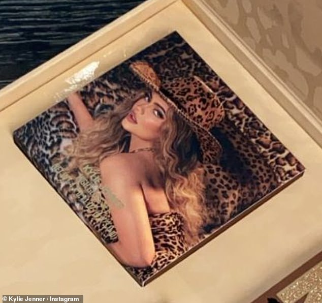 Wild about this new look:The packaging also showed her smoldering while sitting in a chair. And she laid down on a leopard print sofa while in a leopard print cowgirl hat