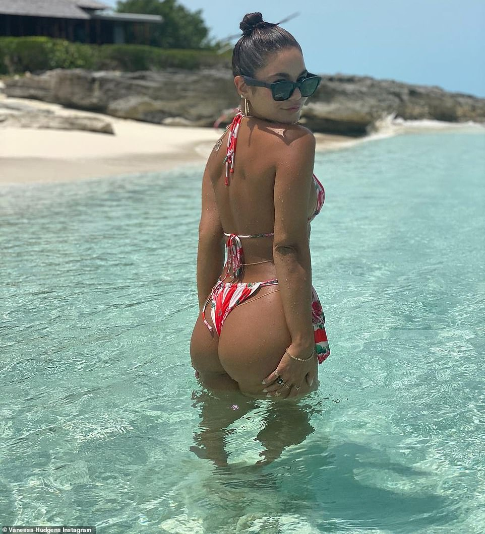 You're welcome, fans:In four snaps the Hollywood pinup is seen in a string bikini while on a pristine beach. The images were taken 'earlier this year,' she said in her caption