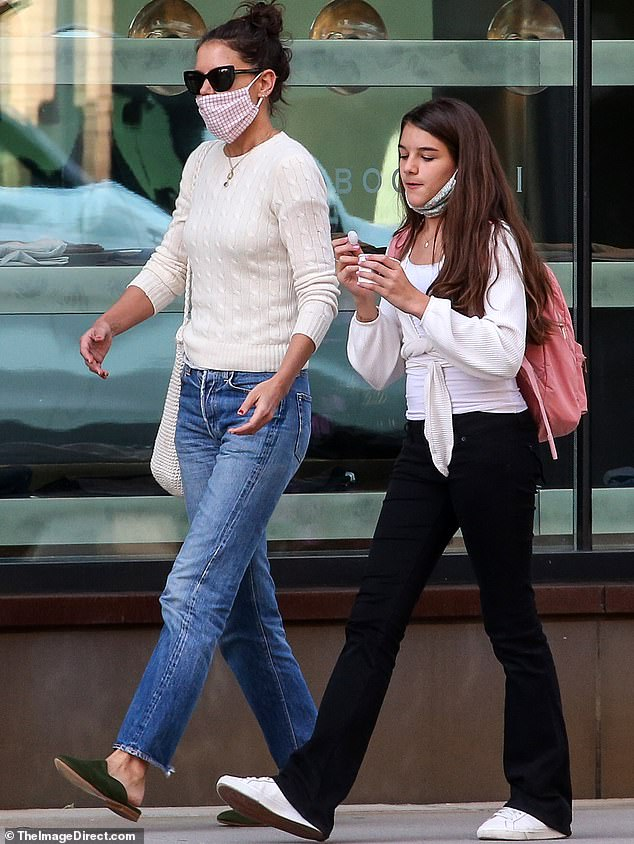 Out and about: Katie is pictured this September enjoying a stroll in New York City with her 14-year-old daughter Suri whom she shares with her ex-husband Tom Cruise