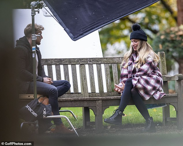At odds? The pair engaged in another lengthy park bench chat after their dramatic showdown on MIC