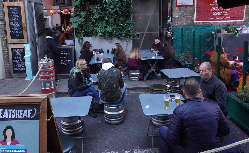 Everyone made the most of the weather in central London this afternoon as they got the drinks in ahead of pubs closing for another month