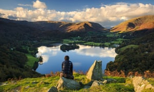A walker admires the view of Grasmere from Loughrigg fell - as Dorothy Wordsworth would have two centuries earlier.