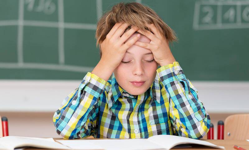 bigstock-Young-Boy-Concentrating-On-His-70106485