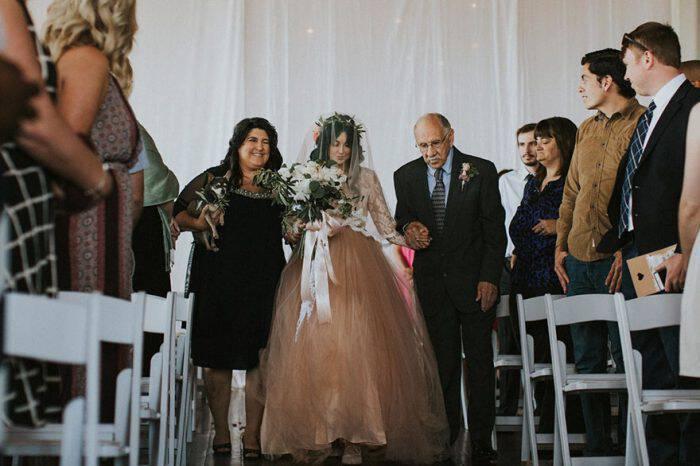 bride-walks-wedding-700x466