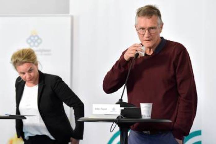 State epidemiologist Anders Tegnell of the Swedish Public Health Agency and Johanna Sandwall of the National Board of Health and Welfare prepare for a coronavirus press conference in Stockholm (Reuters)