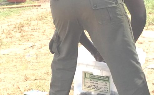 Policeman Caught Using Ballot Box To Wash Uniform In Bayelsa