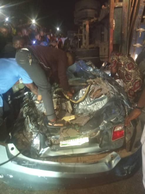 Four Escape Death In A Car Crushed By Fallen Container In Lagos