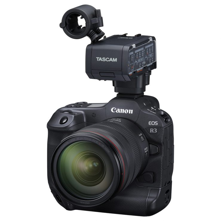 Canon EOS R3 mirrorless camera with a 24-70mm lens, and a Tascam XLR adapter CA-XLR2d attached.