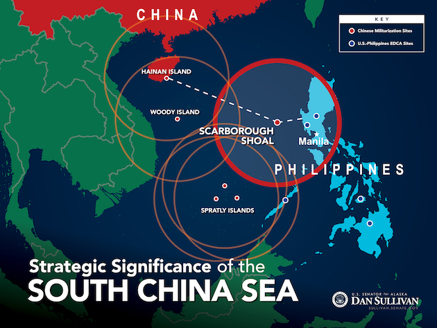 Image: China's continued military build up on contested islands in South China Sea is boosting risk of conflict